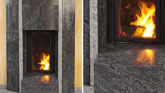 """Massive Kaminverkleidung in dunklem Granit """"Orion"""". Als Kontrast: Intarsien in hellem Granit """"Lavendular""""."""