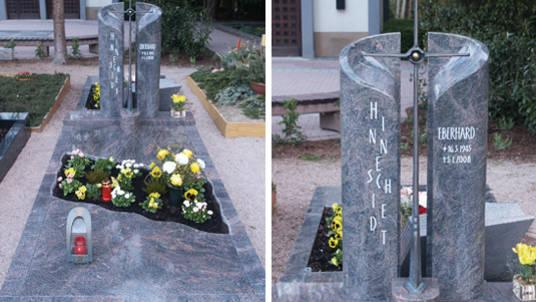 Grabsteine aus Granit in rot und grau mit Bronzekreuz.