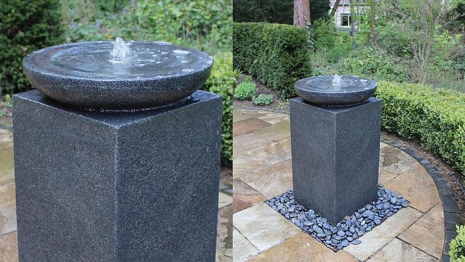 Brunnenschale mit Beleuchtung aus grauem Granit
