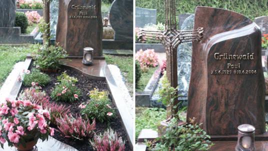 Gedenkstätte mit geschwungenen Platten aus Granit, rot und dunkelgrau, mit Bronzekreuz.